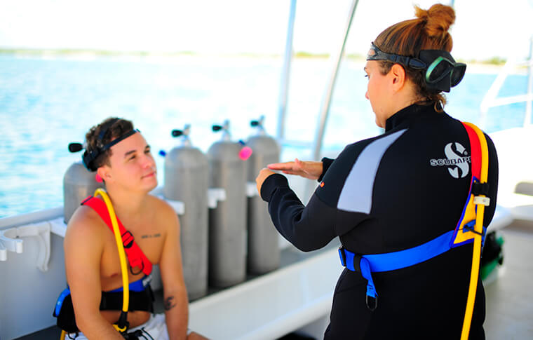 Teacher instructing student on snorkeling on the boat