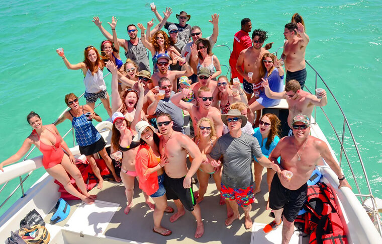 Large group of people in the shallow water posing for picture