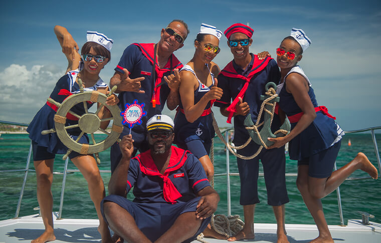 Group of people dressed like sailors on the boat
