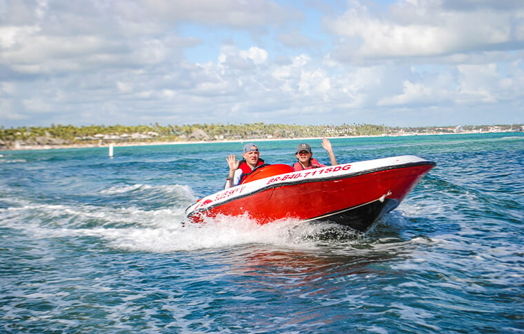 People driving a speedboat
