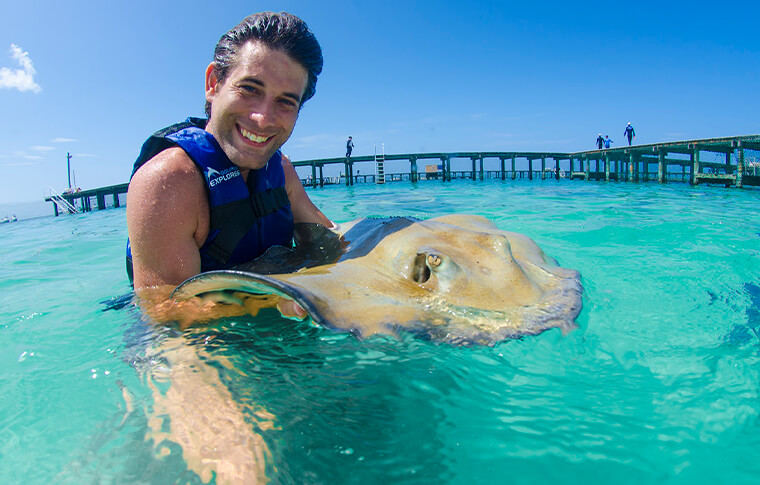 Man holding stingray in the water